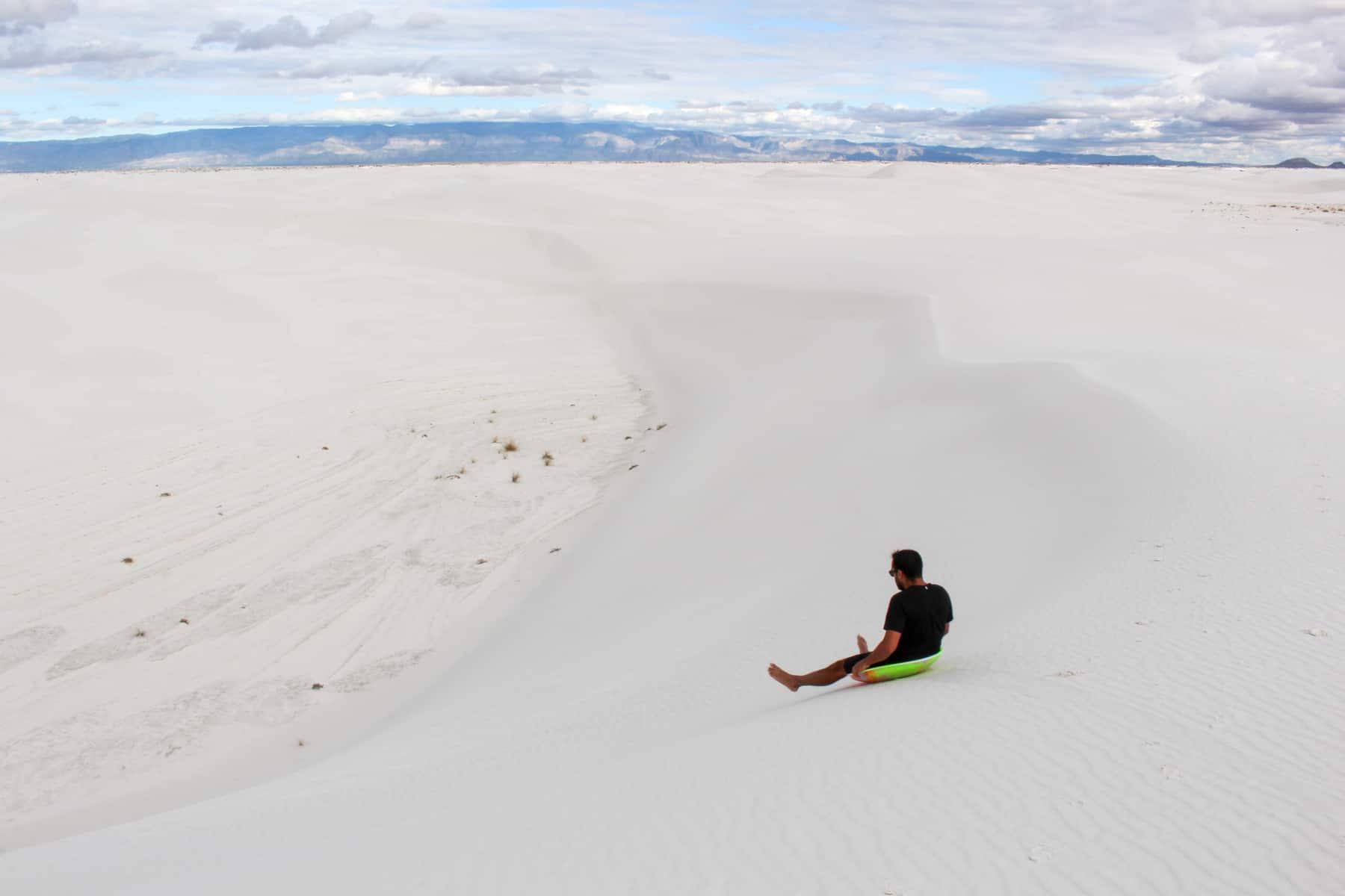 Sledding at White Sands National Monument